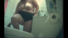 Big girl comes out of clothes in bathroom - duration 01:03