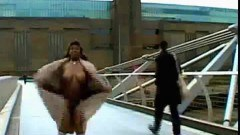 Big black woman walking naked in London - duration 00:26