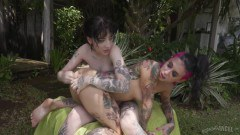 Joanna Angel and Charlotte Sartre licking pussies and fingering asses outside - duration 07:56