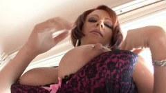 Busty redhead masturbating