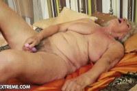 Blonde granny toying