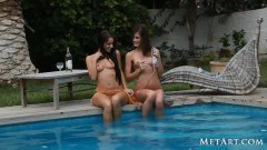 Caprice and Melisa by the pool