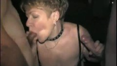 Granny sucking on two guys