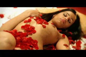 Nude Indian woman On Bed With Rose Petals