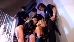Busty blonde sucking three cops