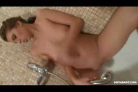 Busty teen brunette plays in the tub