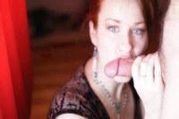 Hot redhead eating a hard peach