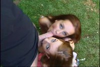 Two redheads in outdoor sucking