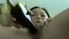 Horny asian babe fucking her hairbrush
