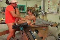 A busty babe rammed in workshop