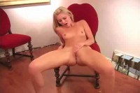 A blonde teen masturbating