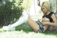 Cute blonde schoolgirl masturbating outdoors