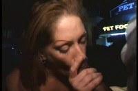 Mature redhead brit blowing a guy in public