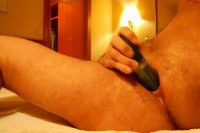 A gay guy inserting dildo in ass