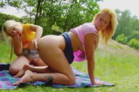 A blonde lesbian couple masturbating in nature