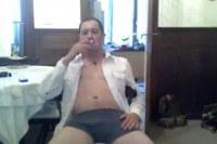 Guy in his underwear smoking