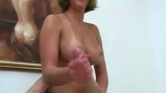 Busty babe massages his very hard cock