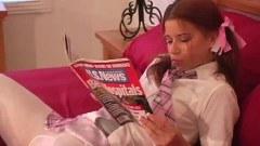 School girl Sara Black strips on her bed