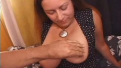 Huge breasted mom getting some young cock in