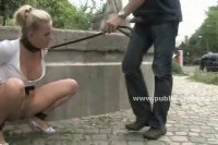 Naughty blonde on a leash