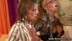 Bukake babes covered in cum while they masturbate