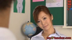Two naughty students are having fun with their beautiful teacher