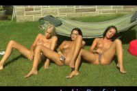 Horny lesbians toying in the backyard