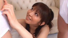 Busty Harumi Asano sucking on two hard dicks