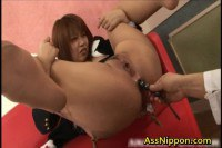 Screaming busty Asian gets ass toyed deeply
