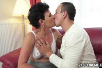 Brunette granny pumped by young cock