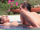 Two lesbian beauties playing in the pool