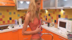 Kitchen solo time for this sexy blonde teen