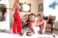 Mature blonde domina spanking her husband's ass