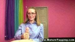 Horny MILF with glasses shows her cock tugging skills