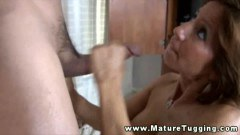 Busty cougar mom wanking this stud's dick