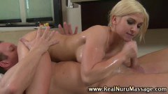 A busty blonde masseuse milking cock