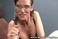 Busty mature with glasses gets a nice facial