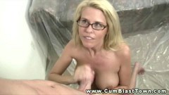 A busty housewife gives handjob