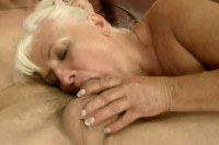 A horny blonde mature babe has a young guys cock sucked