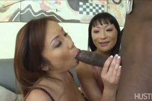 Two dirty sluts sucking on a black cock!