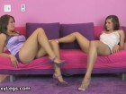 Two beautiful babes in high heel showing off thier sexy legs