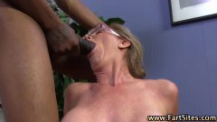 Busty cougar does two black cocks