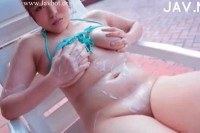 Playful asian makes her lover run after her on fields.