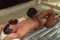 Hot ebony masseuse sucking on her client's dick