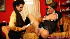 Two breathtaking lesbian chicks toying their pussies with magic wands