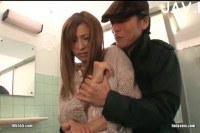 Breasty Asian busted in a public toilet.