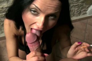 A busty smoking chick gets all cum down her throat!