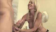Sexy blonde mature tugging a young cock so passionately