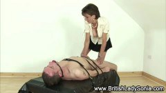 Busty Sonia wanks on her slave