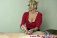 Busty blonde teacher wanking on a pupil